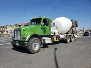 Concrete delivery and material hauling truck.